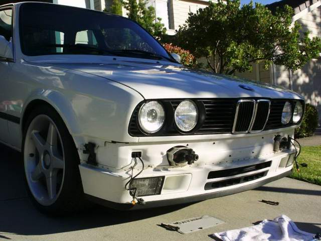 bmw 1989 1991 e30 bumper removal and adjustment once the bolts are removed carefully pull the bumper straight forward and unplug the 2 parking turn signal wiring plugs before laying the bumper down on